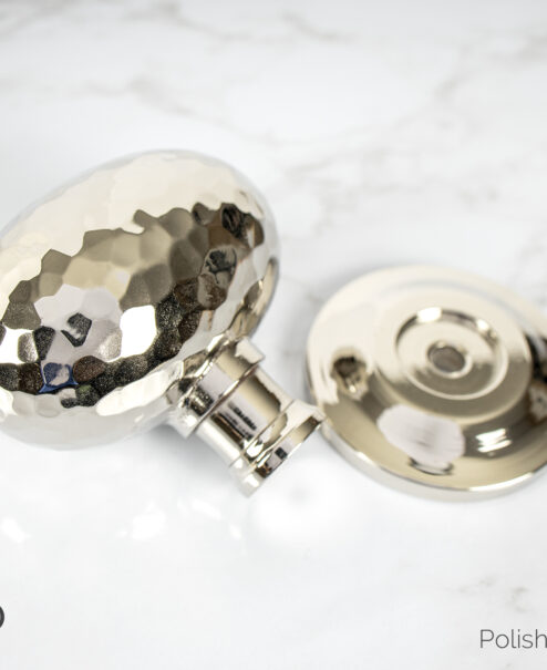 "Hammered Door Knob is the ultimate in door ""jewelry"" with the added benefit of handsome durability for high traffic areas and usage. A combination of strength and beauty, the solid brass hand Hammered Selwyn Door Knob"